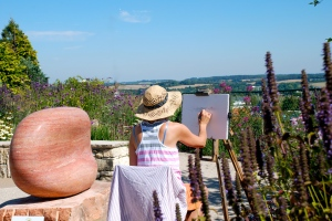 Miranda, drawing in the garden. The landscape beyond forms part of the Clarendon Palace estate. (Photo: Olivia Chapple)