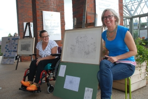 Janina and Miranda with Janina's artwork at Sunday's event (photo: Olivia Chapple).